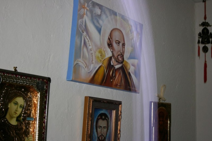 Spiritual Energy Healing by Healing Channels light ray points toward photo of st ignatius of loyola - John of God Crystal Bed Therapy