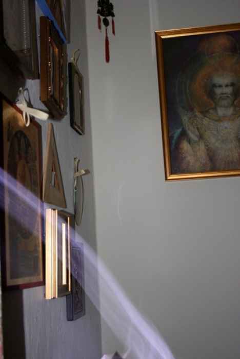 shaft-of-light-bends-towards-icon-of-all-saints